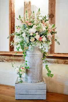 Original Milk churn filled with wild and rustic flowers at Clock Barn. Scented sweet peas, Roses, Stocks, and natural foliage. Designed and created by www.hannahberryflowers.co.uk | Photo Credit http://www.kitmyersphotography.co.uk