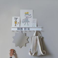 Bon dia! Have you seen our new coat rack? 8 hooks and a mini shelf to show your art work!