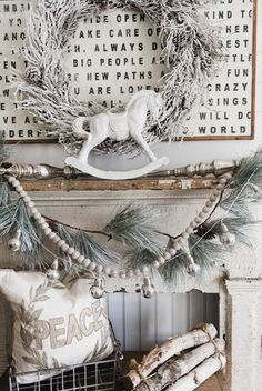 picture-of-shabby-chic-mantel-in-off-white-a-snowy-wreath-garland-and-logs