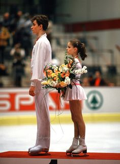 Ekaterina Gordeeva and Sergei Grinkov (Russia) on the podium after earning the gold medal at the 1986 World Figure Skating Championships in Geneva, Switzerland.