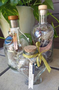 Snakeskin sheds in three glass bottles. A heart-shaped bottle and two whiskey bottles with corks. The sheds are in three sizes--kingsnake, python, and OMG is that a boa! Snake Shedding, Ball Python, Wine Bottle Crafts, Corks, Make And Sell, Wicca, Glass Bottles, Snake Skin, Fun Crafts