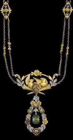 A tourmaline and diamond pendant necklace