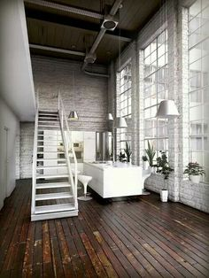 warehouse conversion. Rustic white textures with polished floor