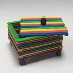 trinket box... I think this is a unisex project for both boys and girls... use colored sticks if for a one time project.  You don't need to paint.  make it last longer for option, and embellish it!