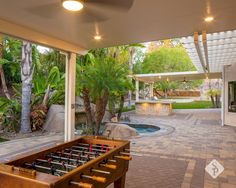 A backyard remodel should encompass elements that make your outdoor space the ideal retreat or oasis if you will. Elements featured in this project that were designed and installed by System Pavers include: a custom gas fire pit with oversized paver bench seating, paver patio and courtyard, double pergolas, an oversized bar top with attached built-in bbq, wine refrigerator, outdoor electrical hookups, and over 500 square feet of artificial turf