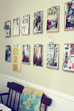 Attach clipboards to wall, swap out pictures/drawings/illustrations/posters at will