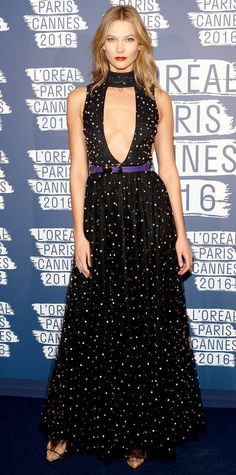 Karlie Kloss took the plunge for the L'Oreal Party at Cannes in a sternum-grazing pearl-embroidered Elie Saab gown with a black collar and a skinny purple belt.