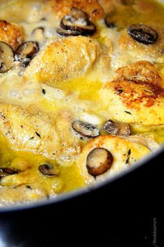 Chicken with Garlic and Mushroom         3 tablespoons butter      3 tablespoons olive oil      8-10 chicken thighs      20 garlic cloves, peeled      1 cup mushrooms, cleaned and sliced      1 cup chicken stock      ¼ cup half and half      1 tablespoon fresh thyme or 2 teaspoons dried      salt and pepper to taste