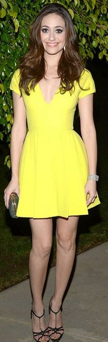 Who made Emmy Rossum's sandals, clutch handbag, and yellow short sleeve dress?