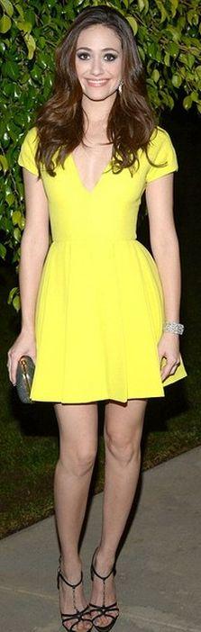 Who made Emmy Rossum's sandals, clutch handbag, and yellow short sleeve dress?