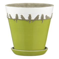 """A charming row of birds perches on the """"line"""" around the rim of our handcrafted terra cotta pot. Tapered pot with drainage saucer is glazed spring green with a white rim that highlights the decoration."""