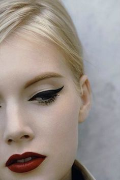 Lovely black winged liner and red lips.