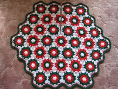 Crochet Christmas Tree Skirt.  Easy and fun crochet pattern that will help add a touch of classic holiday colors to your Christmas decorations.