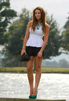 Love this lookpeplum white top and black shorts