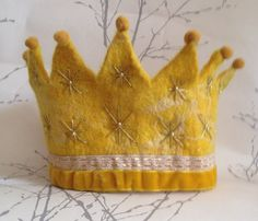 Hmmm, pretty sure I could make something similar. Really cute design! I like the balls at the end of the points. Golden stars Waldorf Birthday Crown on Etsy, $80.00