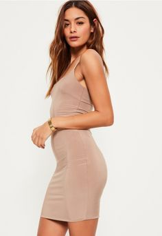 Slip into slinky and opt for nude wearing this beaut' mini dress - featuring thin straps and a mini length.