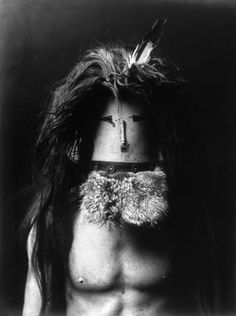 A Navajo man wearing a mask of Haschebaad, a benevolent female deity. Photograph by Edward Curtis, c1905.