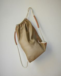 DEUTSCHE & JAPANER - Creative Studio   drawstring-leatherbag - box calf leather at a size of 35 x 55 cm and a weight of about 800g