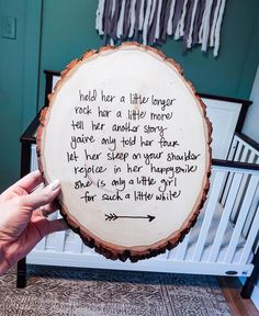 Hold her a little longer Rock her a little more Tell her another story You've only told her four Let her sleep on your shoulder Rejoice in her happy smile She is only a little girl For such a little while Poem written on a rustic wood round with permanent marker. Great nursery wall decor for baby girl's nursery. #nursery #walldecor #babygirlnursery #babygirlroom #girlnursery Woodland Nursery Girl, Girl Nursery, Rustic Nursery, Woodland Baby, Little Girl Poems, Little Girls, Nursery Themes, Nursery Ideas, Mothers Day Presents