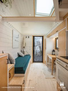 The Athena: a beautiful 220-sq-ft tiny house with a netted loft area! Designed and built by Swiss builder, Woody Way.