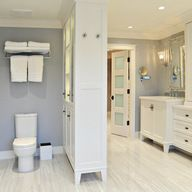Love how the door is painted and the towel bar above the toilet. No room for the divider, but love that, too!