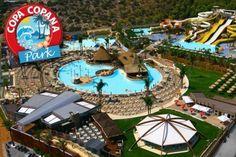 Το Copa Copana Park αποτελεί το μοναδικό πάρκο ψυχαγωγίας νερού στην Αττική. Βρίσκεται στο Χαϊδάρι, σε απόσταση μόλις 15 λεπτών από το κέντρο της Αθήνας και απευθύνεται σε όλη την οικογένεια. Πρόκειται για ένα πολυθεματικό χώρο που προσφέρει υπηρεσίες αναψυχής, διασκέδασης και εστίασης. Μέσα σε μία έκταση 40 στρεμμάτων έχει δημιουργηθεί ένα εξωτικό σκηνικό, που περιλαμβάνει 17 Νεροτσουλήθρες με τις περισσότερες διαδρομές στην Ελλάδα και 2 πισίνες. Επισκεφθείτε το με 50% έκπτωση. Outdoor Furniture, Outdoor Decor, Park, Water, Fun, Home Decor, Gripe Water, Decoration Home, Room Decor