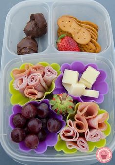 Turn an ordinary plastic container into a divided plastic container using cupcake liners.
