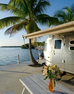 Glamping in Florida Glamping on Florida's West Coast in RV Parks: There are a few RV parks right on the beach, such as Red Coconut RV Park in North Ft. Myers beach, and Calusa Campground Resort and Marina in the Florida Keys. Or Bluewater Key Resort (picture), 10 miles from Key West where most every spot has it's own dock. Some spots even have underwater light that makes it a living aquarium at night. Via Ginger Goes Glamping. Bring your own RV, or look for a rental!