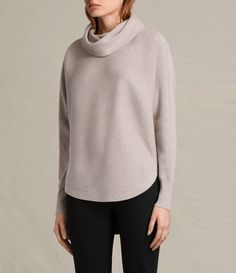 """An essential style for every knitwear collection, the Rio roll neck jumper is an easy, relaxed shape with batwing sleeves, side splits and a stepped back hem. Made from an equal blend of wool and cotton, it's just the right weight for spring.Slouchy roll neck.Batwing sleeves.Side splits.Curved front hem.Stepped back hem.Ribbed knit. SIZE & FIT  Relaxed fit.Model is 5'8"""" / 173cm, size M.See our size guide for more details.  50% wool, 50% cotton.  Hand wash or dry clean.Wa..."""