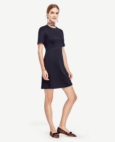 Tailored with a flattering curved seam bodice, this fit-and-flare style flatters with rich color and refined texture. Jewel neck. Short sleeves. Curve seamed front bodice. Hidden back zipper.