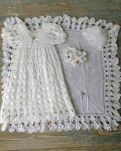 "Watch Maggie review this adorable Blessed Christening Set! Designed by: Maggie Weldon Skill Level: Intermediate Size: Afghan: 31"" square; Gown, Booties & Bonnet: Newborn Materials: Crochet Cotton Thre"