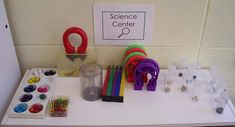 """Magnet explorations.  I would include things that are not magnetic, too, such as copper, aluminum, plastic, glass, etc.  I see she does have some non-magnetic objects in her """"magnet tubes."""""""