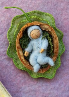 Sleeping nature babies in walnut shell and milkweed pod, set of 8 note cards. $14.00, via Etsy.
