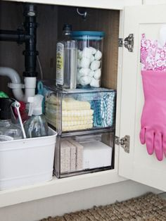 Stack Clear Bins  Get the most out of this tight area by taking advantage of vertical space. See-through bins ensure that you'll never lose track of extra kitchen sponges or cotton balls.