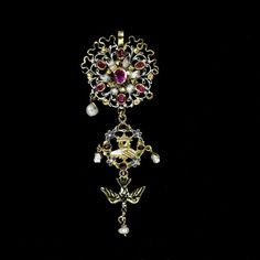 Enamelled gold openwork pendant, set with rubies and hung with pearls. The pendant drop is formed of clasped hands beneath a crown with a dove below. France, late 17th century