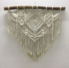 **This piece has sold** If you purchase this listing, you are placing a custom order for a replica. Please keep in mind that your end product might differ slightly from the images above. Size is approximately: Driftwood: 100 cm (39) Macrame length: 80 cm (35) Material: Cotton rope,