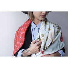 Pin for Later: 21 Unique Ways to Wear Your Silk Scarf Wrapped Lightly Around Your Shoulders Feel free to knot the scarf at your chest.