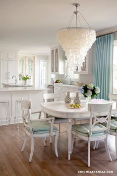 Love this whole look but especially Capiz Shell Chandelier- mine is rectangle and not sure how it will look over new round table...