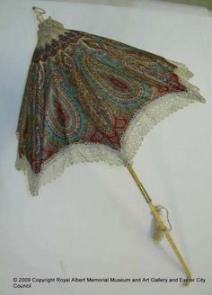 W. & J. Sangster of Regent Street, London was a well-known parasol manufacturer. The firm registered their designs to prevent copying by other manufacturers. Sangsters' innovative parasols were illustrated highlights in the official catalogue when they showed their designs at the Great Exhibition at the Crystal Palace in 1851. Carriage parasols had sticks or handles that folded so they could be used to shade the face.