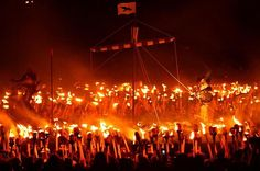 In Lerwick, the capital of Scotland's Shetland Islands, a fire festival named Up Helly Aa is held every January to mark the end of the yule season.  Participants called guizers celebrate their Norse heritage, dressing in Viking gear and marching through town with battle axes and torches as they drag a ceremonial Viking longboat. At the end of the procession, the guizers hurl their torches onto the longboat and set it ablaze.
