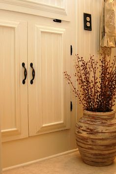 """I want to do this!! """"reused cabinet doors. spruce them up by adding bead board and trim to each door and changing out the hardware."""""""