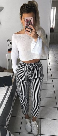 #winter #outfits white off-shoulder long sleeve crop top; black and white pinstripe capri pants and white low top sneakers