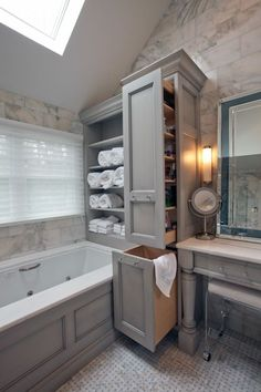 Open shelving; pull-out linen cabinet at foot of soaking tub