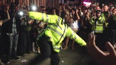Police officers showing their dance moves to an appreciative crowd at the Notting Hill Carnival