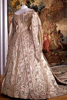 "CORONATION DRESS OF EMPRESS ALEXANDRA FEODOROVNA | Gown by Atelier of Olga Bulbenkova, Brocade by Firm of A. & V. Sapozhnikovy | Moscow, Russia | ca.1896 | Coronation held on 26 May 1896 | brocade, silk, silver tissue, pearls, lace, embroidery | ""This coronation gown is a splendid example of the dress of the so called 'Frenchified sarafan' or 'train' type. Several tailoring firms provided their services to the court aristocracy..."" 