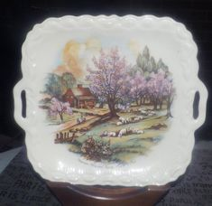 Vintage (attributed 1960s) Currier and Ives American Homestead Spring handled cake, cookie or pastry serving plate.