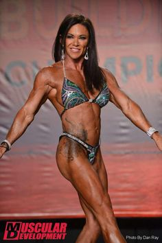 Rose Brunner in a custom Cherry Bombs competition posing suit at the 2014 Tampa Pro Show.