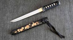 Tanto--Japanese short sword with lacquer work. Shorter than a wakizashi.. In the west, a tanto is often referred to as a Japanese knife. For the Japanese they were all swords, the name tanto being used for the shortest blades.