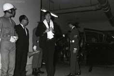 June 30, 1966 Paul McCartney of The Beatles returns to the hotel after the band's first concert at Budokan, Tokyo, Japan