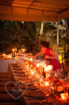 Nicole Freeland, Beach House wedding extraordinaire lighting candles for her beautiful table.